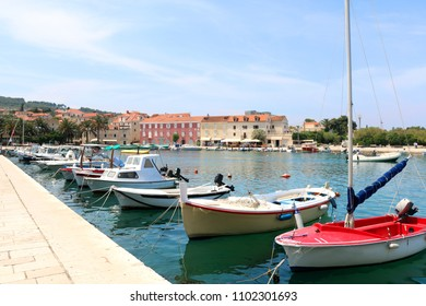 Colorful boats in port of Supetar, Brac island, Croatia. Supetar is popular summer travel destination.