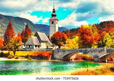 Colorful Bohinj Lake, Church of St John the Baptist with bridge. Triglav National Park, Julian Alps, Slovenia,Europe