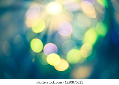 Colorful bokeh background. Abstract blurred circles bokeh lights in green and yellow.