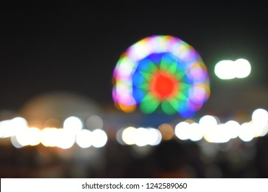 Colorful bokeh background of ferris wheel, canival concept.