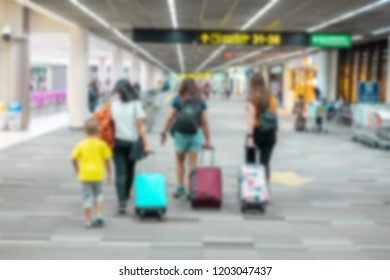 Colorful bokeh , blurred crowd of travelling people thailand. Traveling concept. Travelers asian  walking with a luggage at airport terminal , airport terminal vintage tone color , advertise concept ,