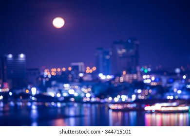 Colorful bokeh of city skyline from the sea in night time