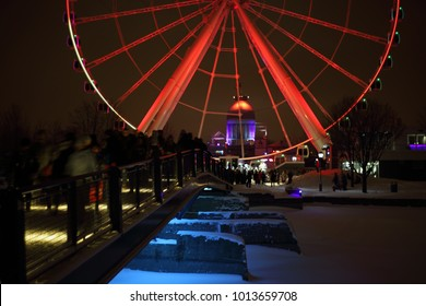 Colorful bokeh on defocused background. Buble bokeh effect. Great wheel of Montreal colorful silhouette by night. luminous colorful ferris wheel in the Old Port.