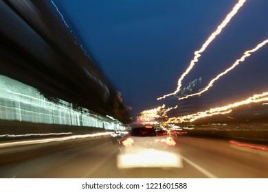 Colorful bokeh with street lights at night time, motion movement with traffic light in the city on car windshield view, blur background, long exposure.