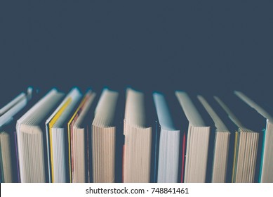 Colorful books on the table. Closeup of counterfoils. Abstract concept of knowledge, education, learning, and literature. Filter