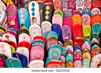 Colorful boots in the lines exposed at the local market, background full of colors