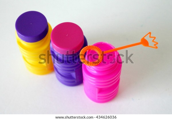 colorful bottles of bubbles with bubble wand