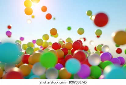 colorful bouncing balls outdoors against blue sunny sky