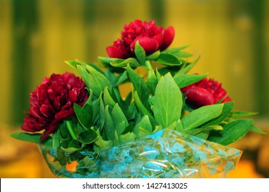 Colorful bouqet of vine red peonies