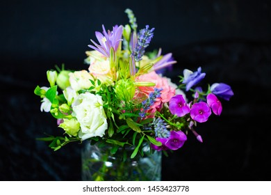 colorful bouquet, black background, birthday greetings