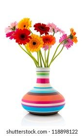 Colorful bouquet Gerber flowers in modern striped vase