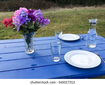 Colorful bouquet on blue picnic table