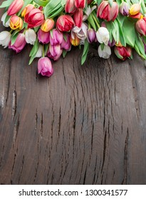 Colorful  bouquet of tulips on old wooden background.  Top view.