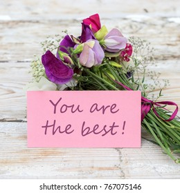 colorful  bouquet with vetch and greeting card with text: You are the best