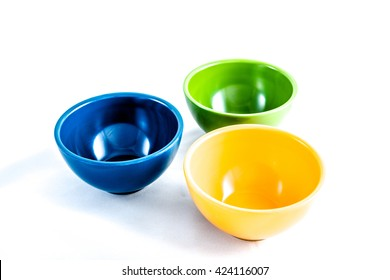 Colorful bowls on white background