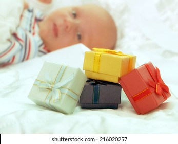 Colorful boxes gifts on background Baby.