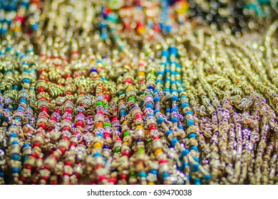 Colorful bracelets, beads and necklaces souvenir for sale on street at Khao San Road night market, Bangkok, Thailand.