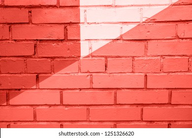 Colorful brick wall background. Living Coral color of the year 2019.