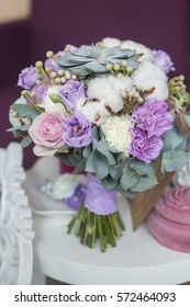 Colorful bridal pastel beautiful bouquet of different flowers. Wedding summer or spring bouquet