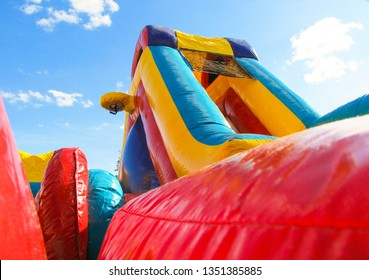 Colorful and bright bounce house outside.