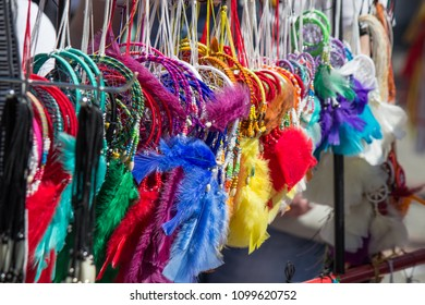 A lot of colorful bright dream catchers hanging on the counter of the market
