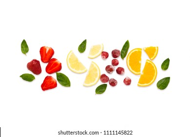 Colorful bright fruit, strawberry, cherry, lemon, orange, mint leaves on a white background light. Flat lay, top view.