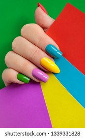 Colorful bright manicure with different nail shape,sharp,oval and square.Nail art.Summer creative nail design.