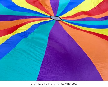 Colorful and bright parachute background. Childhood background. Copy space