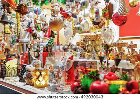 colorful and bright stall with christmas tree decorations at vilnius christmas market in lithuania selective