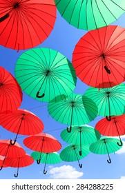 colorful bright umbrellas in the blue sky