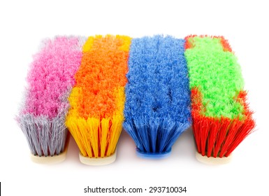 Colorful brooms isolated on white background.