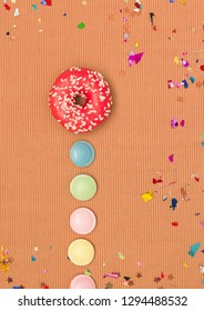 colorful brown canival background with donuts and other funny items