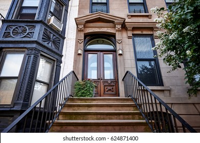 colorful brownstone building in an iconic neighborhood of Brooklyn, New York City.