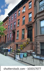 Colorful Brownstone Home Trash Cans in Gated Area Urban Residential Neighborhood Brooklyn New York