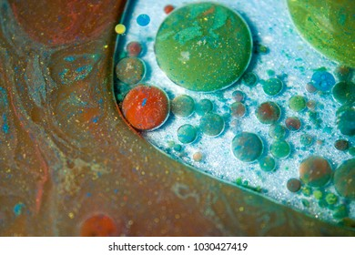 Colorful bubbles of water and oil close up view, selective focus on center with shallow depth of field