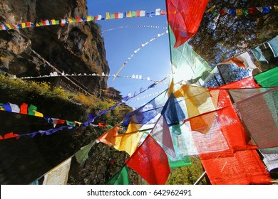 Colorful Buddhist prayer flags at Taktshang Goemba or Tiger's nest monastery in Paro, Bhutan.