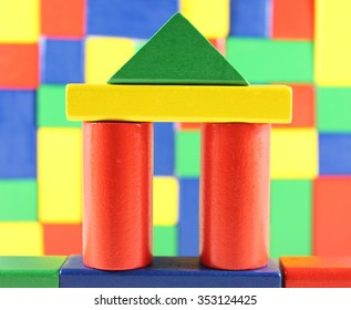 colorful building bricks in front of block wall