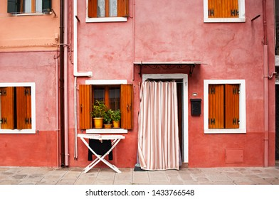 Colorful building in Burano island in Venice. Italian street