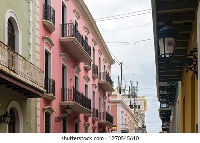 colorful building facades and balconies line streets of old san juan puerto rico