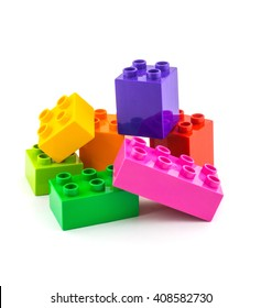 Colorful building plastic toy blocks isolated on white background