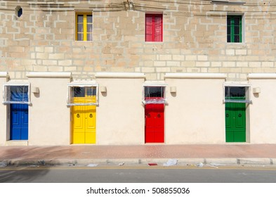 Colorful building in small maltese village Marsaxlokk in Malta. Four colorful front doors of the house. Colorful architecture in Malta. Exterior. House decor in Malta.