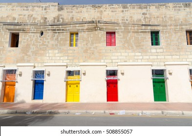 Colorful building in small maltese village Marsaxlokk in Malta. Five colorful front doors of the house. Colorful architecture in Malta. Exterior. House decor in Malta.