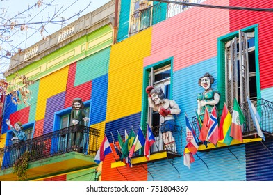 Colorful building and statues in La Boca neighborhood of Beunos Aires, Argentina