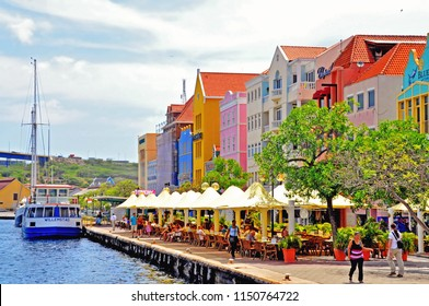 Colorful buildings along the waterside of the port of Willemsta on the Dutch island of Curaçao. (Willemstad, Curacao - 05/03/2011)