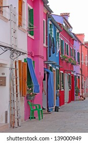 Colorful buildings in Burano island sunny street , Italy