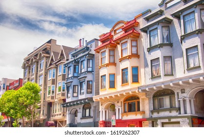 Colorful buildings lining a street in the city of san franscisco california on a sunny blue sky day.