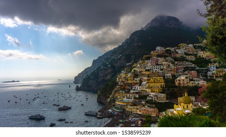 Colorful buildings and mountain background at Positano