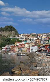 colorful buildings and old fortress Parga Greece
