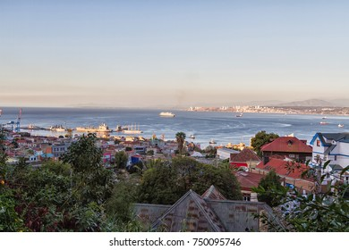 Colorful buildings on the hills of the UNESCO World Heritage city of Valparaiso, Chile. View on the ocean and seashore