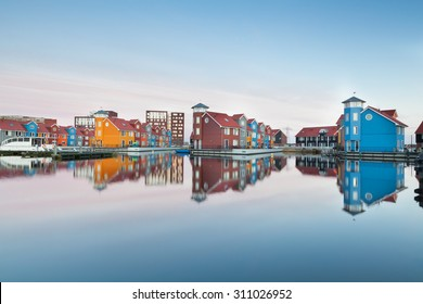 colorful buildings on water at haven, Groningen, Netherlands